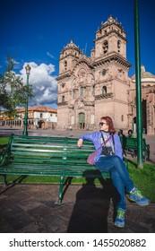 Asia traveller enjoy cusco city at Plaza de arms , Peru
