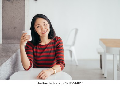 Asia Woman and Coffee Relaxing  in Coffee Cafe  shop