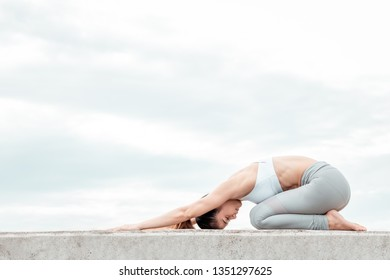 Asia woman doing yoga fitness exercise for relax and healthy, Concept outdoor sport and health