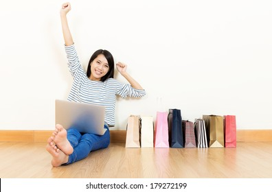 Asia woman excited about shopping online