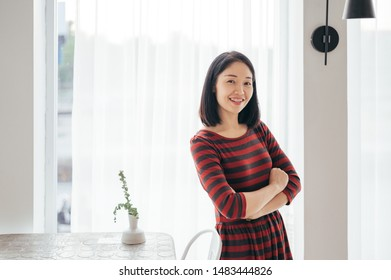 Asia Woman Folded and Relaxing  in Coffee Cafe  shop