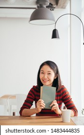 Asia Woman and Green Book  in Co-Working Space Cafe  shop