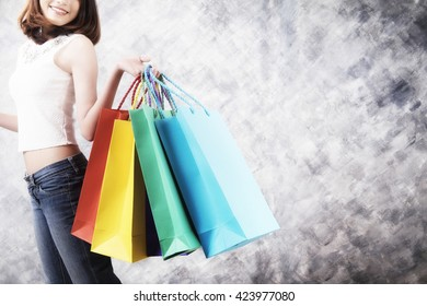 Asia woman holding shopping bags.