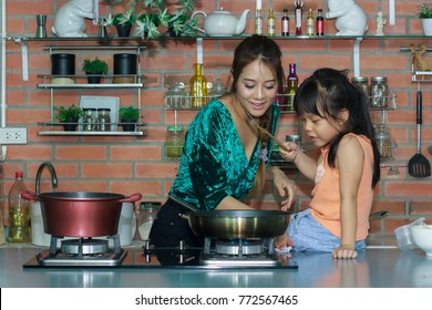 Asia woman with kid cooking at luxury kitchen