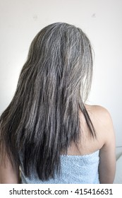 Asia woman is not happy with white fragile and damaged hair on bed, in selective focus on white background for text the word.