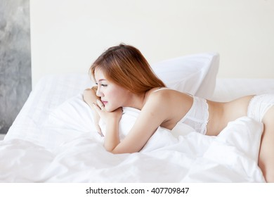 Asia woman on bed