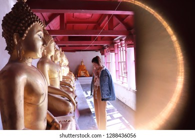 Asia woman pay respect to the Buddha statue