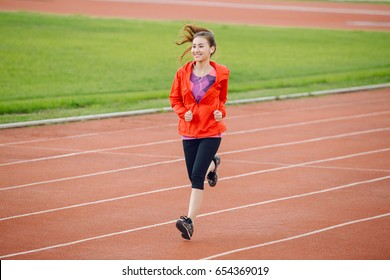 Asia woman runner running exercise