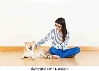 Asia woman with shiba at home