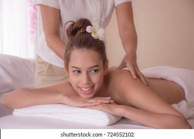 Asia woman in a spa relaxing on a table for a massage.