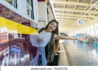 Asia woman Traveller feeling happiness before go to travel at the train station, Travel and lifestyle concept