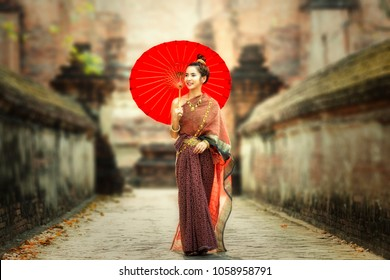 Asia woman wearing traditional Thai dress,The costume of the national dress of ancient Thailand.
