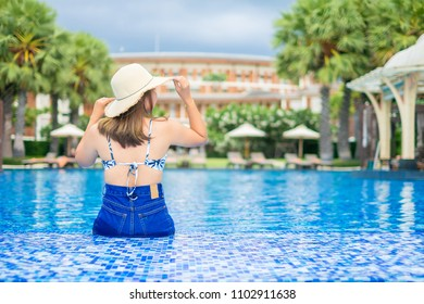 Asia women happiness on pool summer concept.