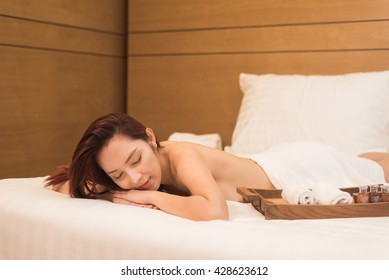 Asia women massage therapy on bed