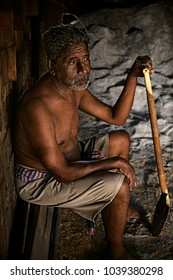 Asia worker man labor Thailand sitting on brick after work hard inside brick factory