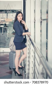 Asia young businesswoman at gate waiting in terminal. Air travel concept with Portrait young casual business woman, Beautiful young mixed race female professional