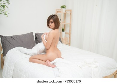 Asia young naked woman in the bedroom.