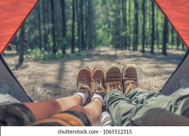 Asia young relaxing enjoying aerial view from tent camping entrance outdoor Travel Lifestyle