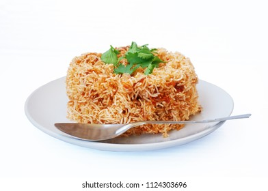 Asia-Asian eating food, Thai food, Mee Grob is an sweet and sour crispy noodles, made from Thai rice noodle with sweet and sour sauce decorated with coriander on white plate isolated on white backgro