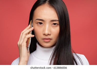 asiam woman with phone
