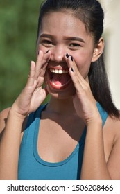 An Asian Adult Female Yelling