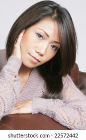 Asian american woman with serious expression