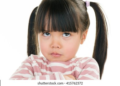 asian angry little girl with pigtail isolated on white