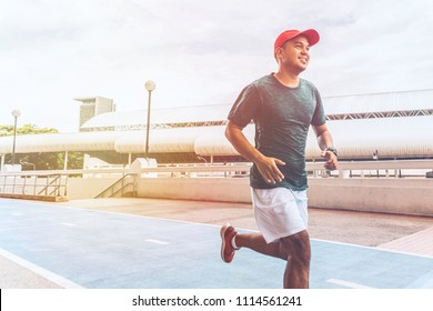 Asian Athlete runner man running in the city. Fitness, workout, sport, lifestyle concept.