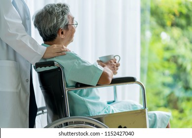 asian attractive woman doctor and nurse takecare old senior patient disabled on wheelchair in hospital health and support ideas concept