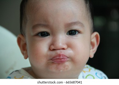 Asian baby boy with his lips puckered up blowing a kiss,baby giving a kiss,xoxo. Duck face