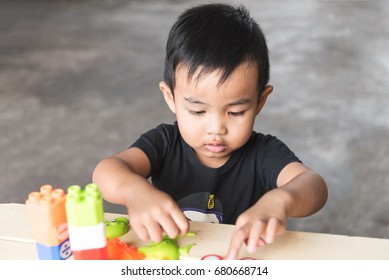asian baby boy play jigsaw,smile and happy