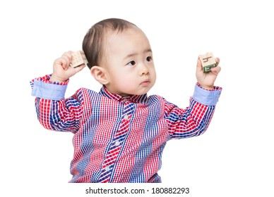 Asian baby boy play with toy block and hand up