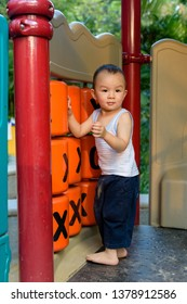 Asian baby boy playing with toys in playground