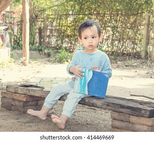Asian baby boy  reading tale book