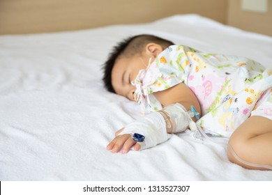 Asian baby boy sleeping on bed with infusion set at child department in the hospital. Children with infectious diseases IPD, Invasive Pneumococcal Disease concept. Infant model one year six months