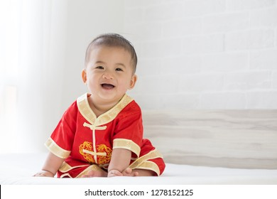 Asian baby boy smiling with traditional Chinese outfit. Dress up for Chinese new year festival concept