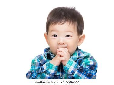 Asian baby boy suck finger