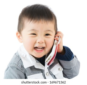Asian baby boy talk to mobile
