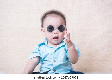 Asian baby child kid posing with glasses