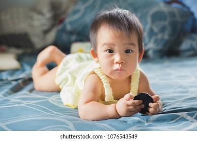 Asian baby crawling at home