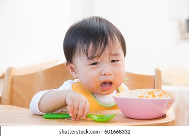 asian baby is crying