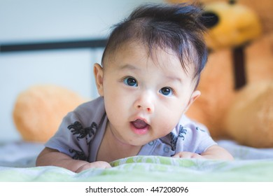 Asian baby cute boy newborn lie on the tummy on the bed