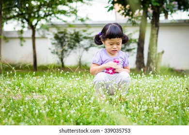 Asian baby cute girl with curly hair cry in the park