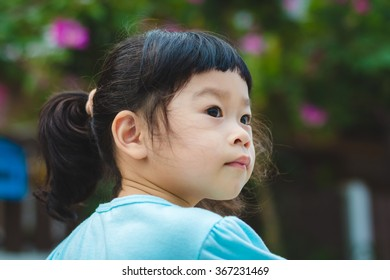 Asian baby cute girl with curly hair