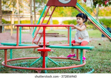 Asian baby cute girl with curly hair in the playground