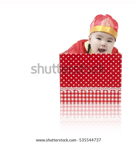 cfb1f8c9353 Asian baby cute and smile wearing Chinese suit or clothes with hat playing  and emerged from the open red gift box for surprise on Chinese happy new  year day ...