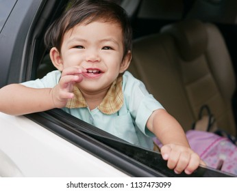 Asian baby girl, 16 months old, in a school uniform smiling in a car  with her school backpack ready to go to school in the morning - early childhood education is a critical phase in human development