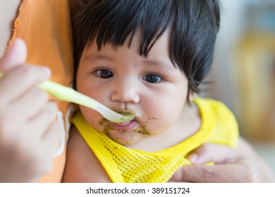 Asian baby girl  eating food