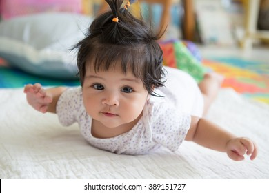 Asian baby girl  laying on floor