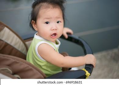 Asian baby girl on stroller.